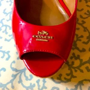 Red patent made leather red COACH shoes size 7.5 B.